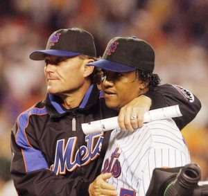 FLUSHING, NY - JUNE 7: Pitching coach Rick Peterson #51 and pitcher Pedro Martinez #45 of the New York Mets celebrate against the Houston Astros during their game at Shea Stadium on June 7, 2005 in Flushing, New York. The Mets defeated the Astros 3-1. (Photo by Jim McIsaac/Getty Images) *** Local Caption *** Pedro Martinez